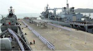Các tàu chiến của Trung Quốc tại đảo Hải Nam. Ảnh: Time